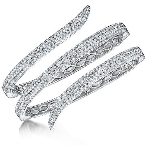 Silver bangle that wraps around the wrist in an elegant swirl