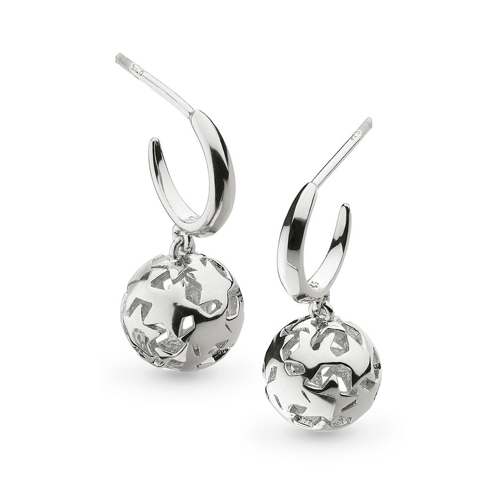 A glamorous pair of silver rhodium plated drop earrings in the shape of an orb made up of twinkling stars hanging from a hoop.