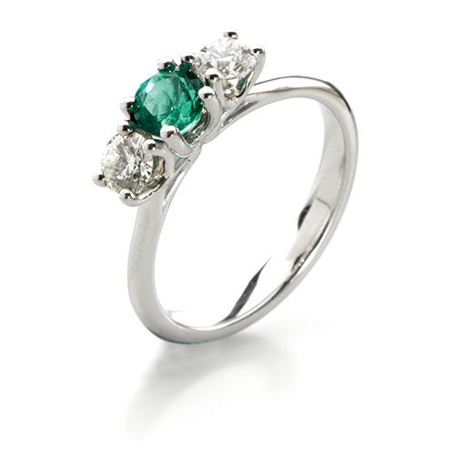 Beautiful emerald shouldered by two diamonds