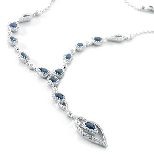 Stunning sapphires shimmering with a surround of diamonds in a drop necklace