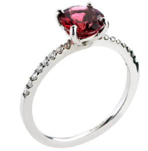 A fabulous 18ct white gold ring set with a round pink tourmaline and diamond set shoulders.